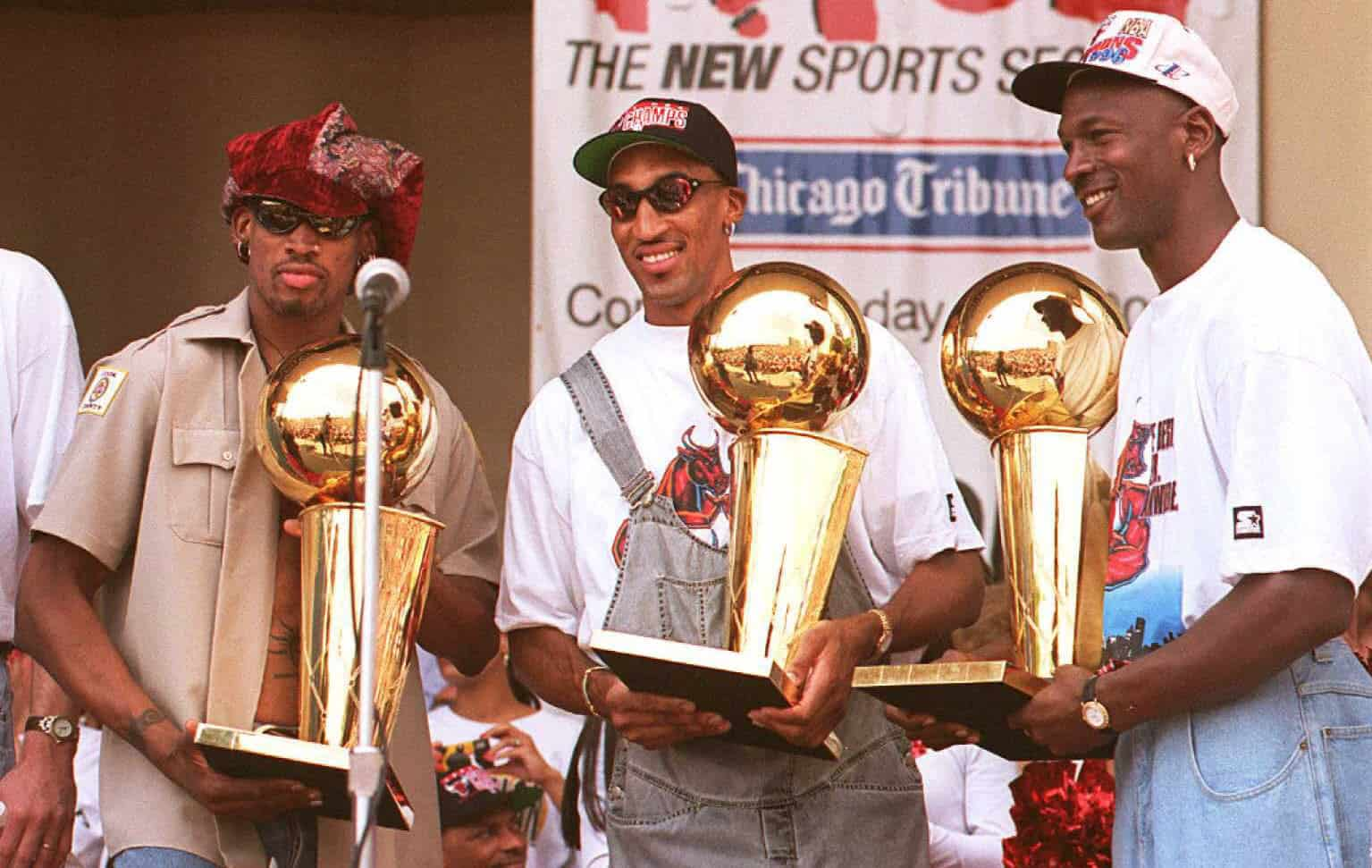 Dennis Rodman receiving awards along with his friends