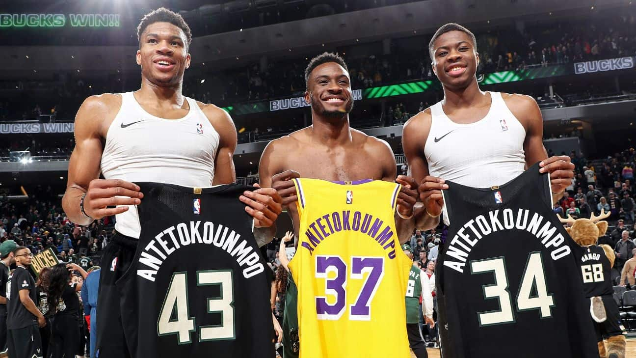 Giannis Antetokounmpo with his brothers