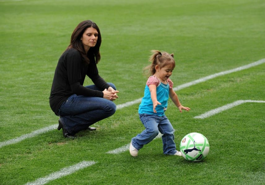 Mia Hamm and her child in the ground
