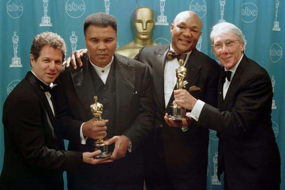 George Foreman and Muhammad Ali with Oscars