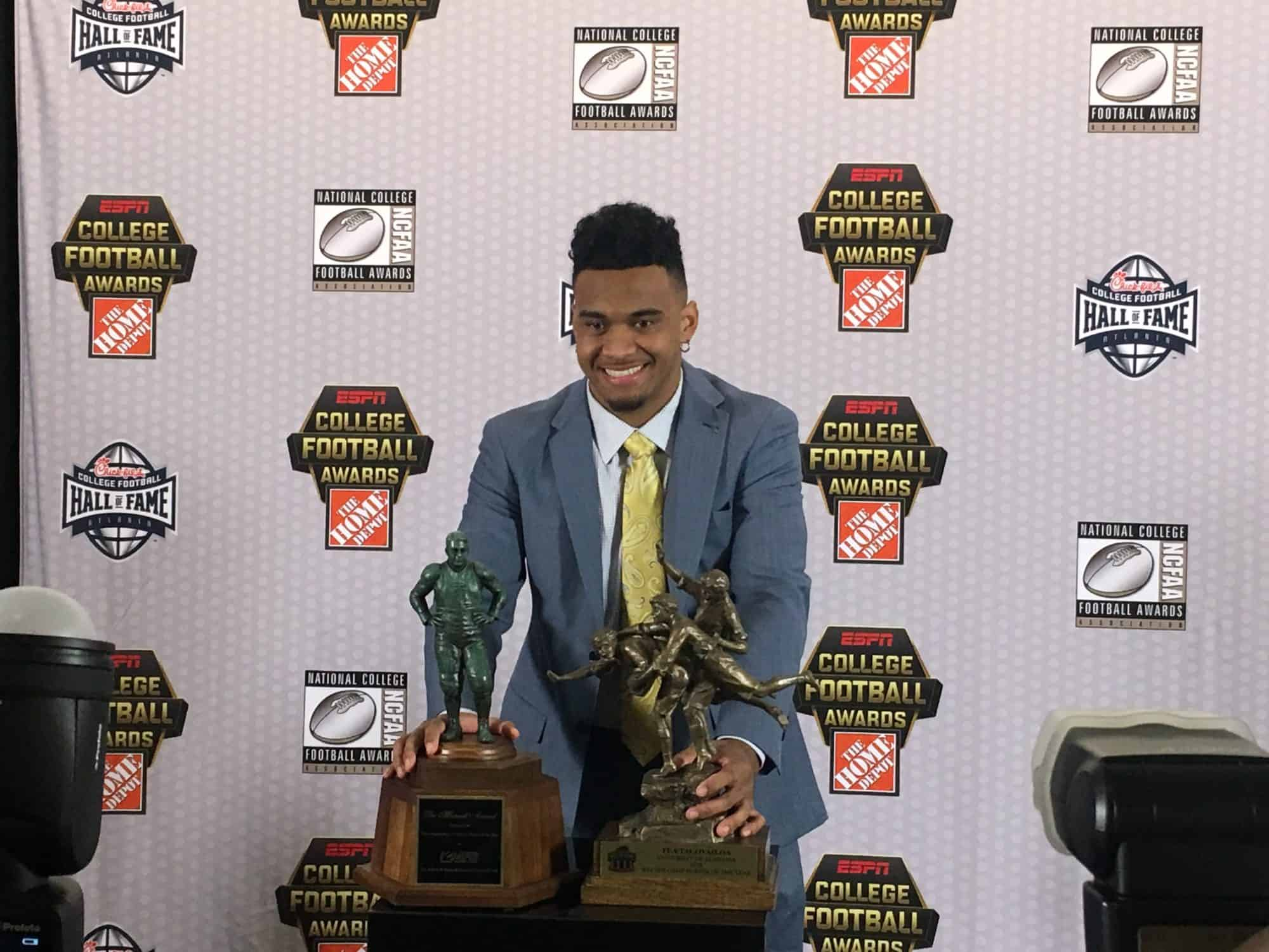 Tua Tagovailoa with his precious award