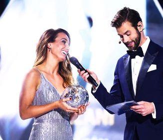 Asllani with her award