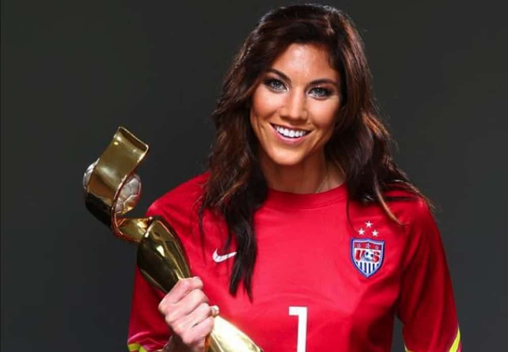Hope Solo with her precious award
