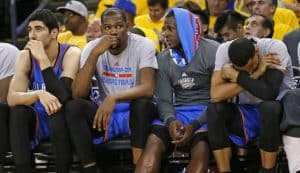 Kevin Durant sits on the bench in the NBA playoff match against the Warriors.