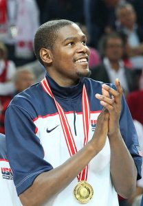 Kevin Durant smiles with Olympic Gold medal.
