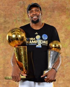 Kevin Durant smiles with his NBA Championship trophy.