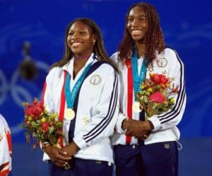 Venus and Serena Williams with gold at Olympics doubles.
