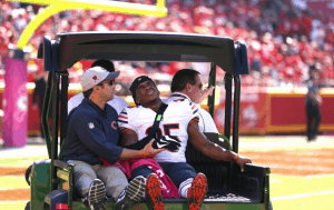 The professional running back carted off the field after serve arm injury