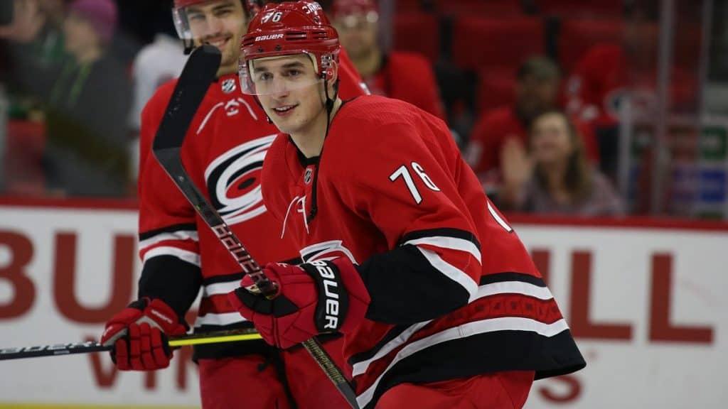 red-black-jersey-hockey-athlete-smiling-
