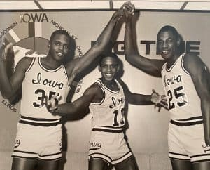 B,J (middle) playing for University