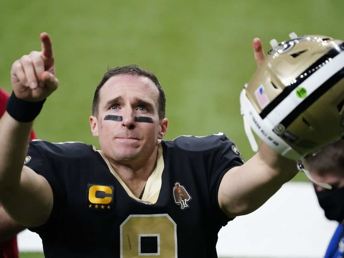 New Orleans Saints quarterback Drew Brees waves to his family and fans after his final NFL game, a playoff loss to the Buccaneers