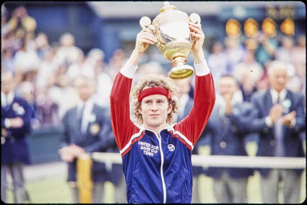 John McEnroe lifting Grand Slam