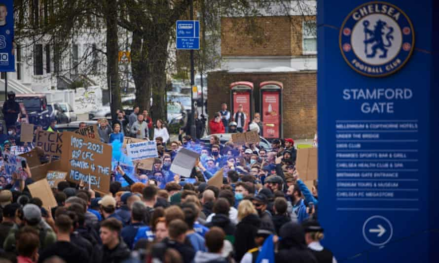 Fans protesting outside the stadium (Source The Guardian)