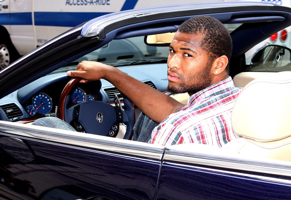 DeMarcus Posing With his Car