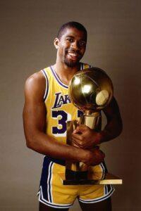 Magic Johson holding an NBA cup