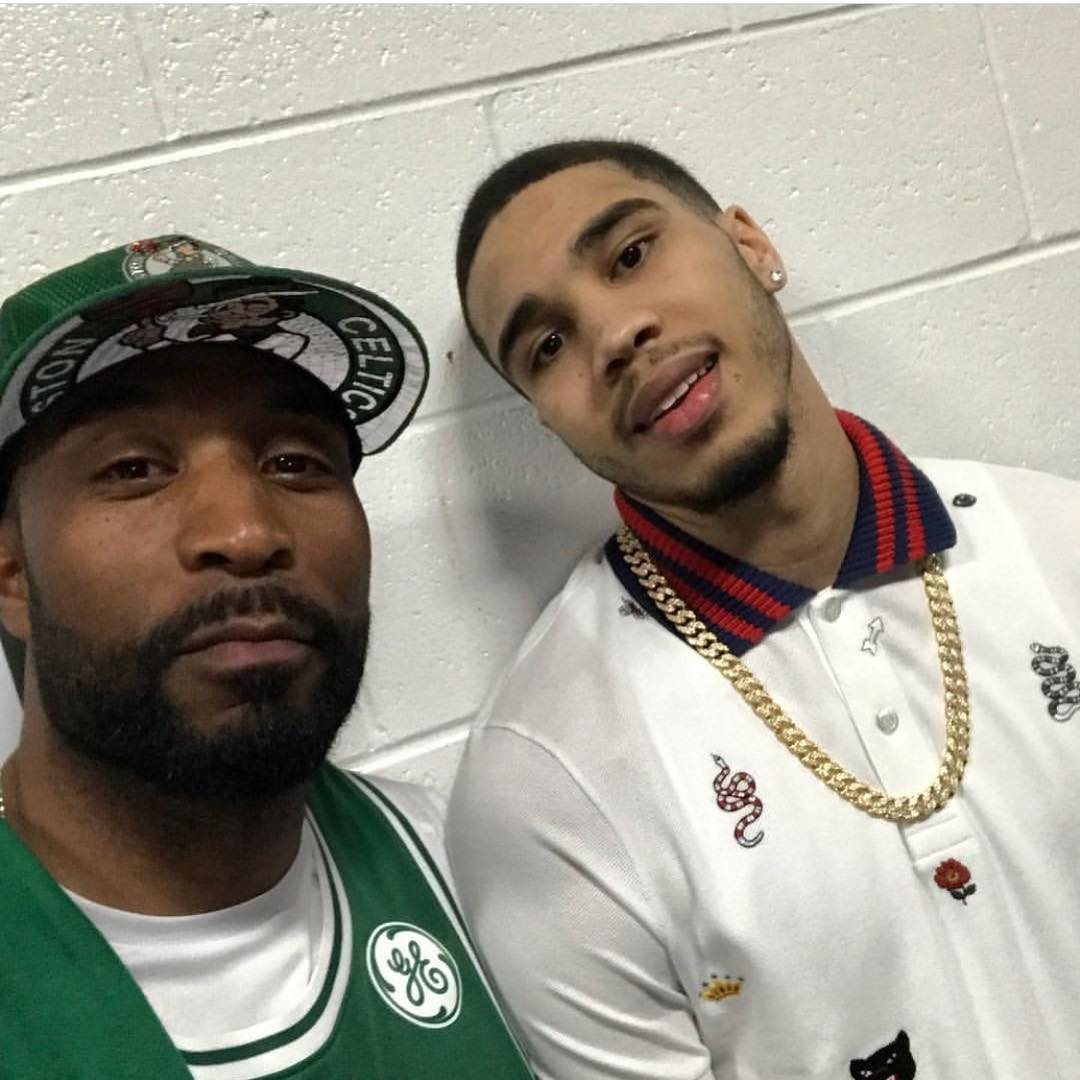 Jayson Tatum showing off his gold necklace