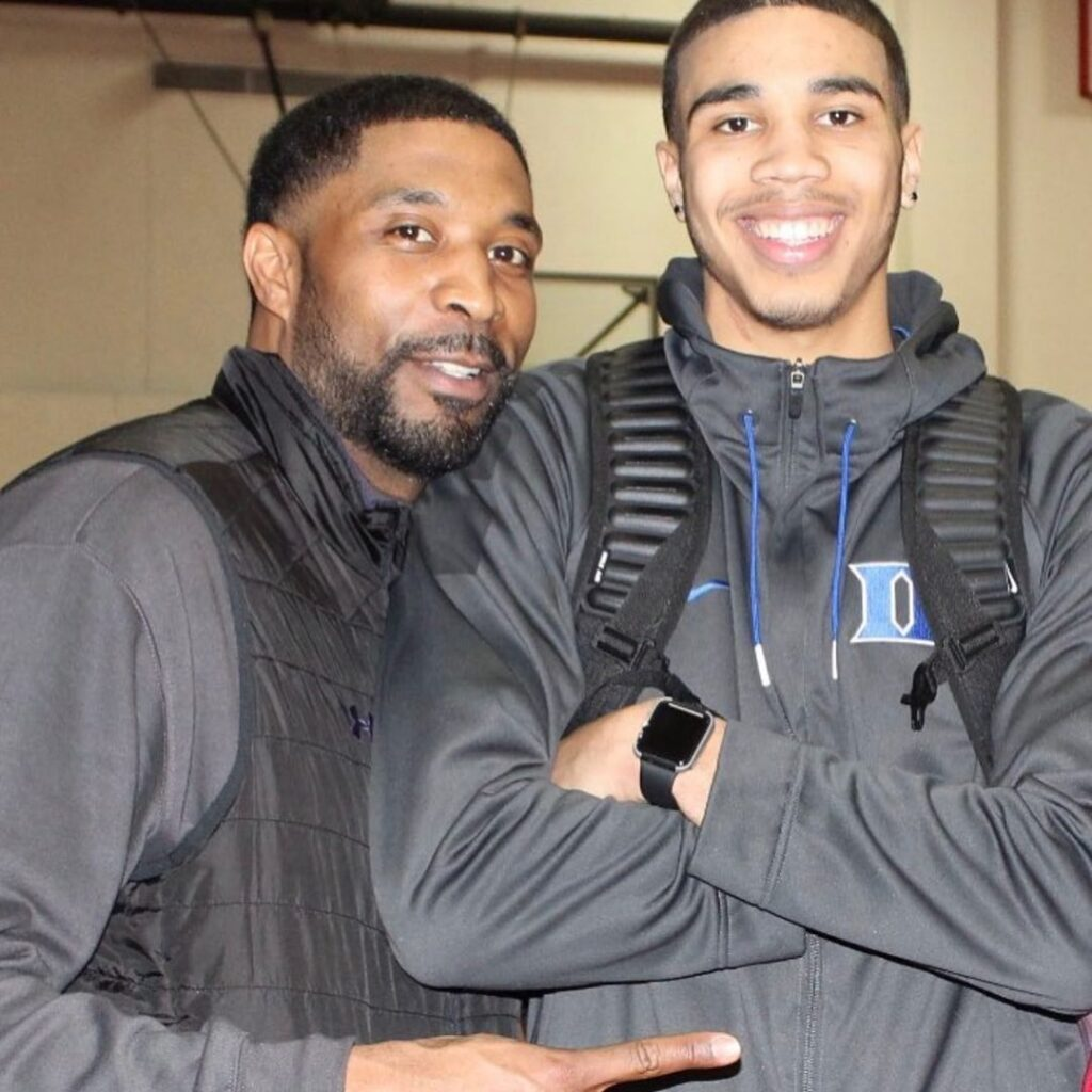 Justin and Jayson Tatum posing for a photo