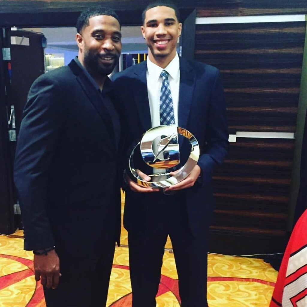 Justin Tatum with son after an award event