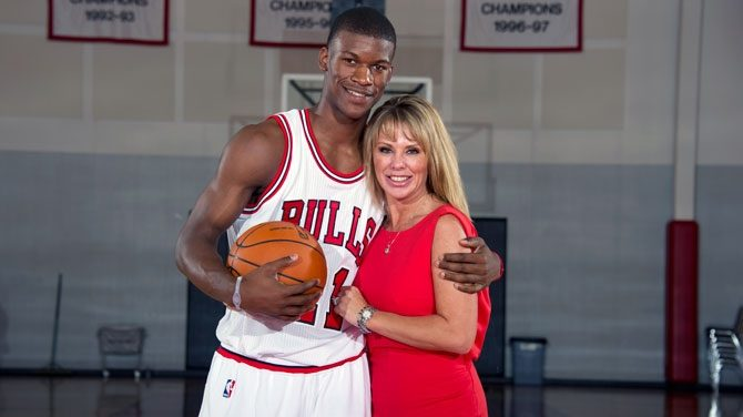 Jimmy Butler with his Michelle Lambert during Bulls introductory press conference.