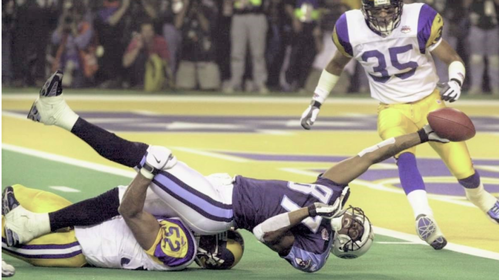 Mike Jones tackles Kevin Dyson just one yards ahead of end line