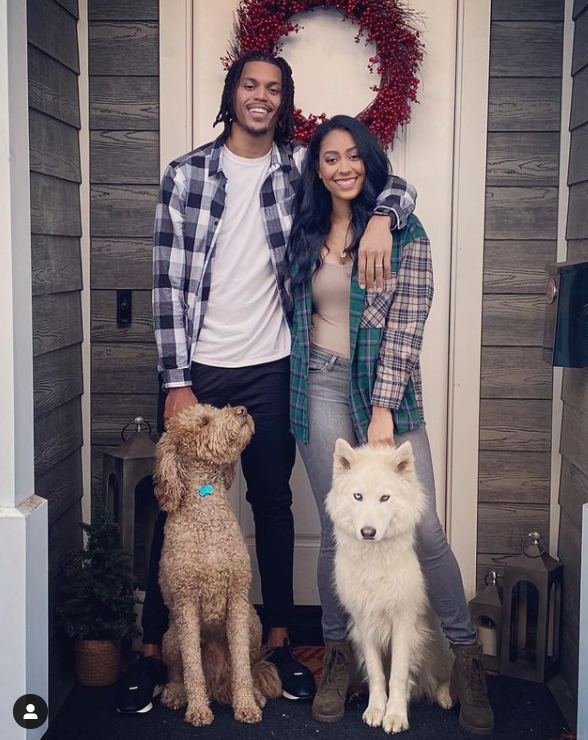 Sydel curry with her husband and dogs