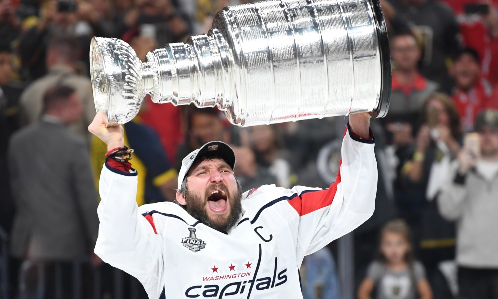 Alex Ovechkin holding Stanley Cup in his hands (Source: USA Today)