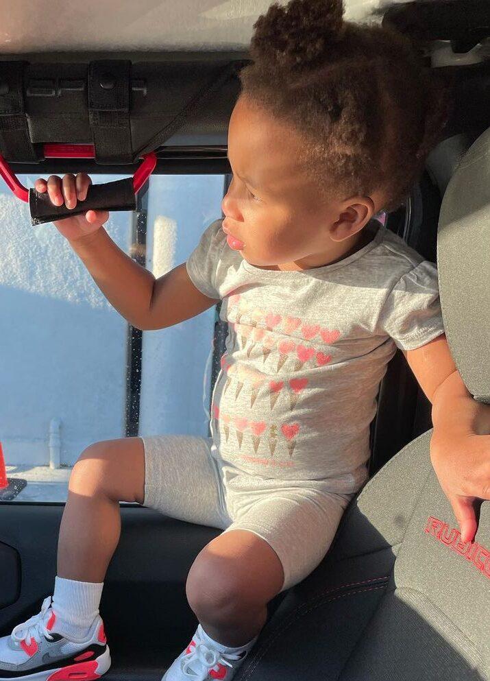 Kenneth Ferguson's daughter in a car