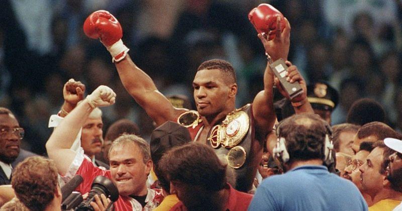 Mike Tyson celebrates after winning championship match